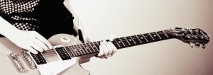 Music-man-playing-electric-guitar-modified